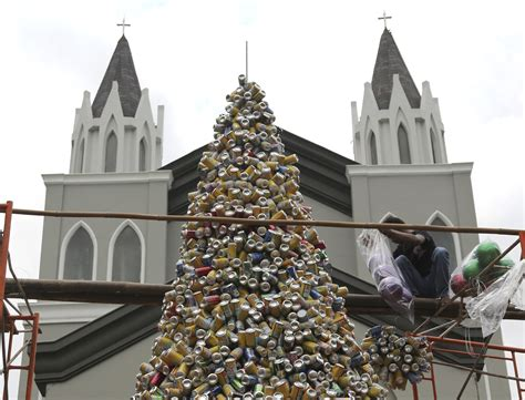 the press viewing the christmas decorations in the grand recycled christmas tree grows in indonesia portland