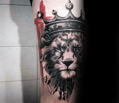 black ink crown on lion head tattoo on left arm 50 lion with crown tattoo designs for men royal ink ideas