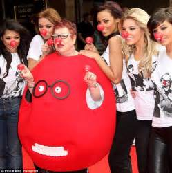 the saturday s mollie king adds a twist to model a nose day t shirt for comic relief