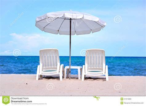 armchair tourist armchair tourist sun beach chairs with umbrella stock