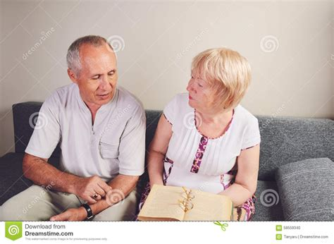 younger boys and women 60 year older man and woman 60 65 years old talking discussing
