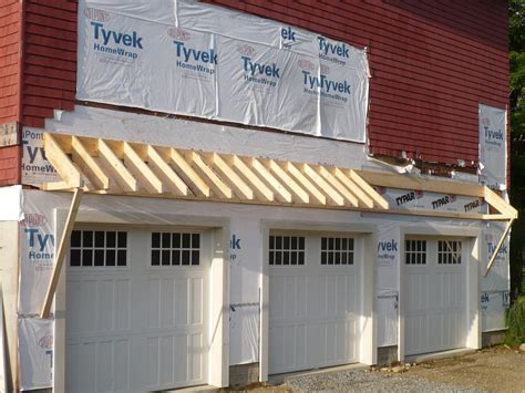garage awnings door overhang on pinterest garage doors side door and deck railings