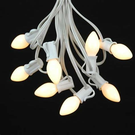 white ceramic c7 outdoor string light set on white wire