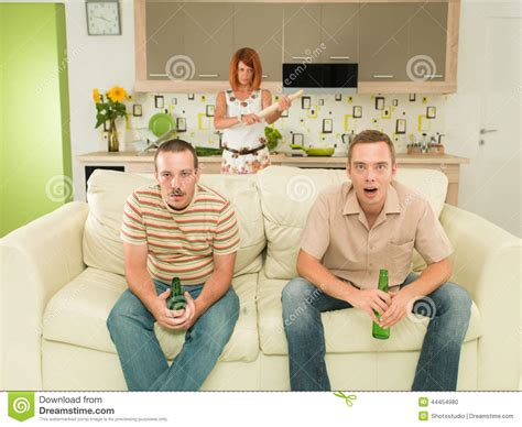 you sitting on the couch watching tv surprised men watching tv stock photo image 44454980