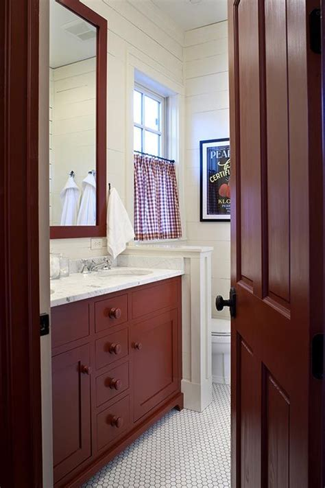 this bathroom with cabinets and mirror painted in benjamin country redwood color