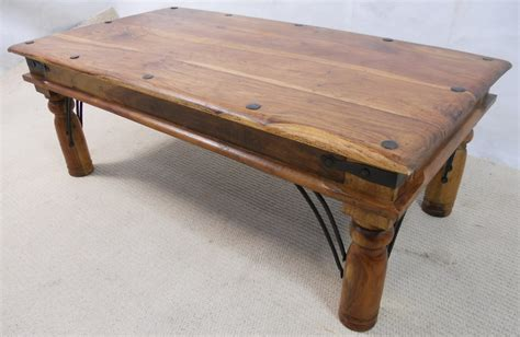 rustic wood coffee table with bolted ironwork