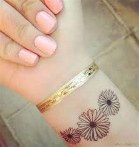 daisy tattoos on wrist 23 pretty flower tattoos for wrist