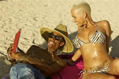 amber rose tattoo of wiz khalifa shows tummy on hawaiian vacation