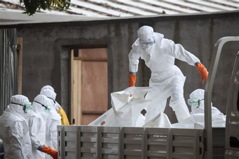 the difficulty of burying ebolas victims smart news smithsonian ebola virus threat to hong kong is minimal say health