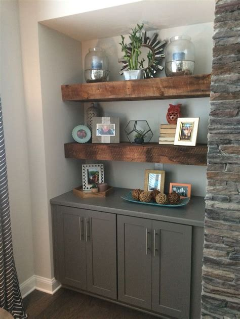 cabinets next to fireplace our beautiful reclaimed wood floating shelves flanking