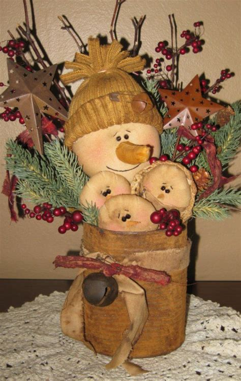 primitive snowman family in a rusty can winter christmas