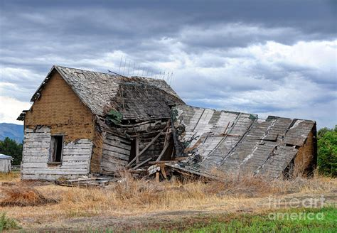 New Farmhouse Plans ruined rural farm house and storm clouds utah photograph