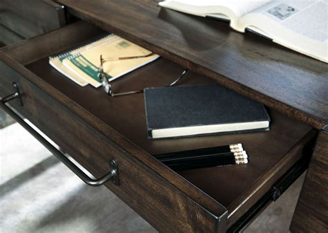 starmore 63 home office desk starmore brown home office set from ashley coleman furniture