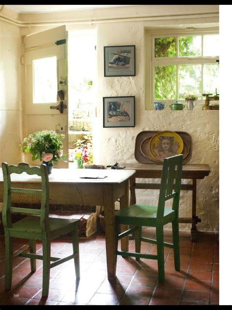 englische cottage kitchen chairs door window light walls space open floor