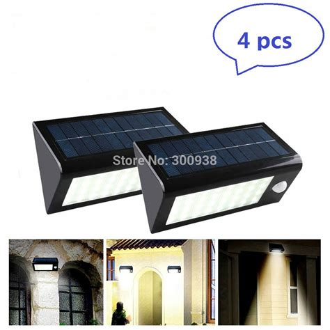 solar powered motion sensor lights 32 led dhl free 4 pack outdoor 32 led solar motion sensor light
