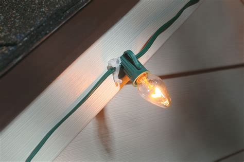 how to hang lights outside with outbusing nails 25 nail on string light string light hangers