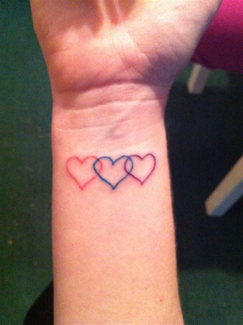 sister heart tattoos three overlapping hearts but smaller and all black your