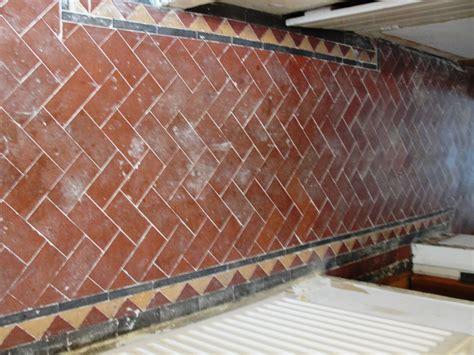 kitchen with terracotta floor tiles wood floors