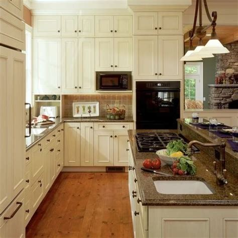brown granite white cabinets and granite on