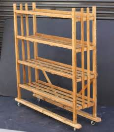 wheeled cart with shelves rolling trolley or display cart with slatted shelves of