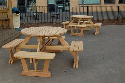 round wooden picnic bench 8 seater round iroko 8 seater picnic table and benches branson