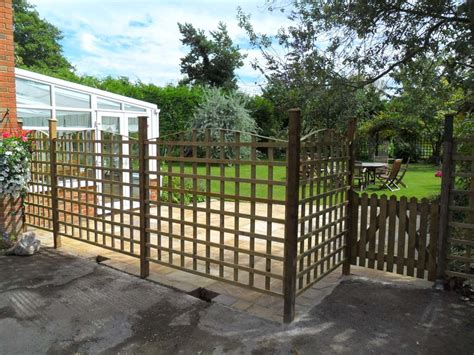 Patio Partition by Paved Patio And Trellis Partition Ammonite Paving