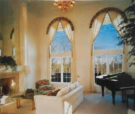 To define the graceful arch of this sunburst window a fabric covered
