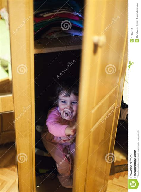 Hiding In The Closet by Hiding In Closet Stock Photo Image 44372768