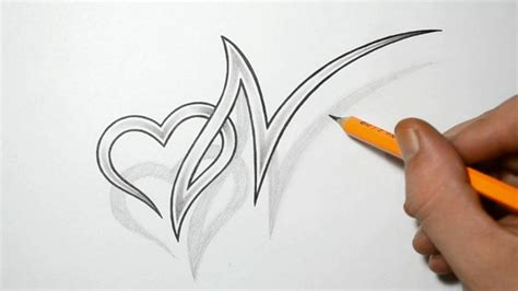 letter n and heart combined tattoo design ideas for