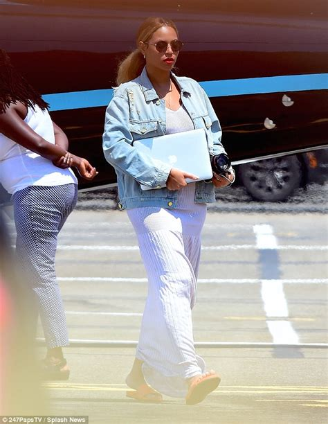 rib boat while pregnant beyonce covers her figure on arrival in new york with jay