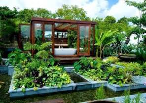 Outdoor bathroom in the middle of a tropical garden