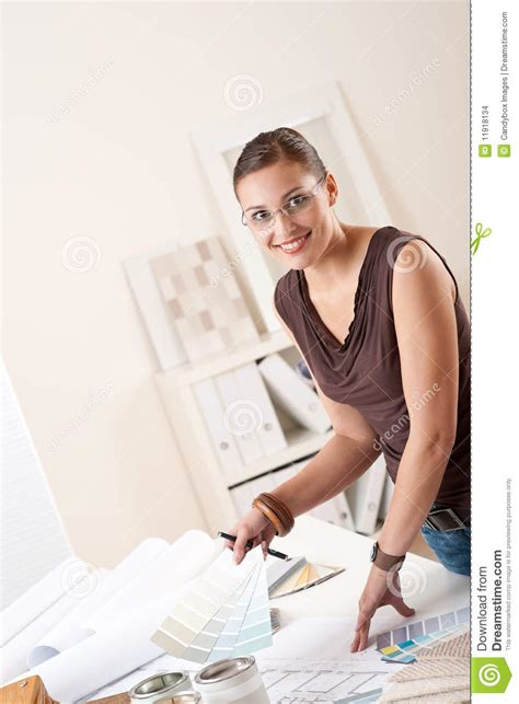 successful interior designer woman at office stock photo