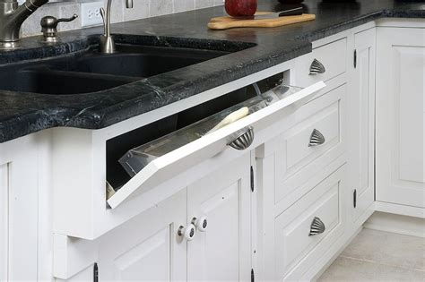 the ideal kitchen under sink drawers live simply by annie tilt out sponge cabinet traditional kitchen mullet