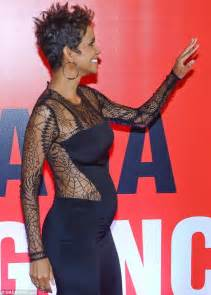 Halle Berry Sporting Baby Bump On Instyle Magazine by Halle Berry Slinks The Carpet In