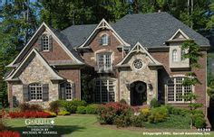 normandy style house plans part 1 by garrell associates rock and stone homes beautiful two story luxury brick