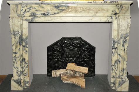 an early 19th century neoclassical marble fireplace