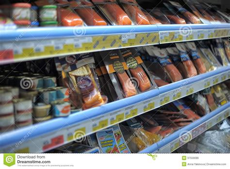 Canned Fish Shelf by Canned Fish And Salted Fish In Supermarket Editorial Photo