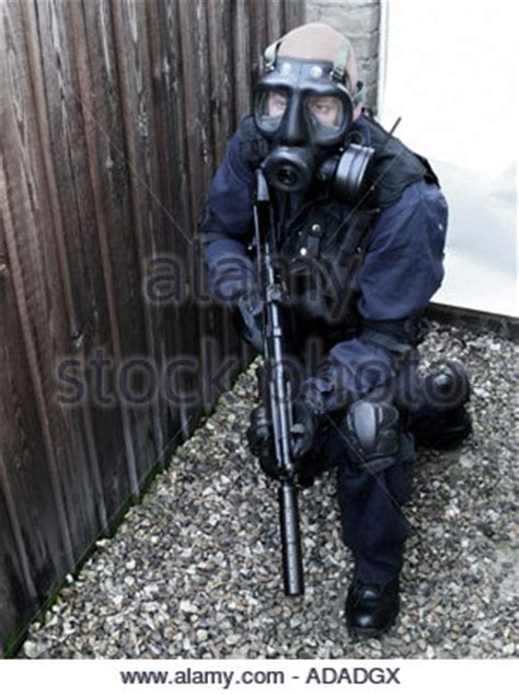 swat officer in gas mask with mp5 machine gun real
