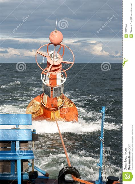 a fireboat in the harbor is helping towing a water hazard stock photo cartoondealer