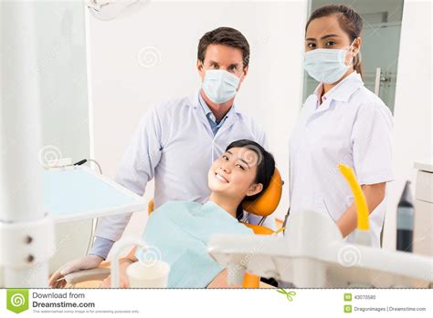dentist assistant and smiling patient stock photo image