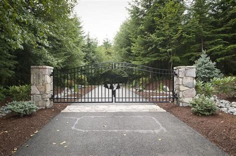 swinging gates for driveways double swing gate with custom laser cut tree design