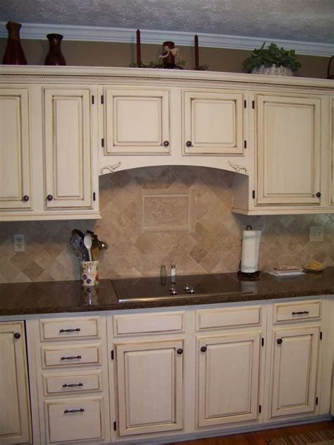 Cream Glazed Kitchen Cabinets | cream cabinets with dark brown glaze diy refinish