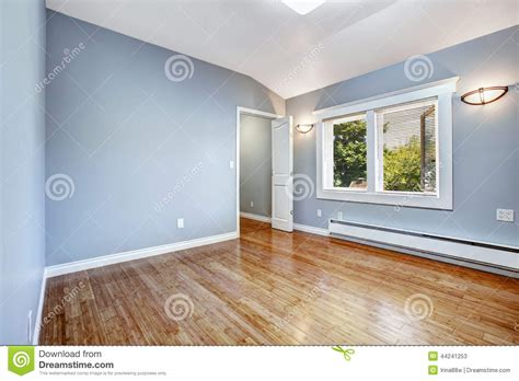 light blue walls and brown wooden doors 3d house free empty bedroom with light blue walls stock photo image
