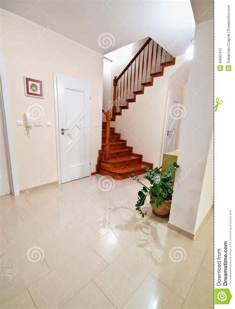 Split Level Home Floor Plans hallway with wooden stairs to upper floors stock photo