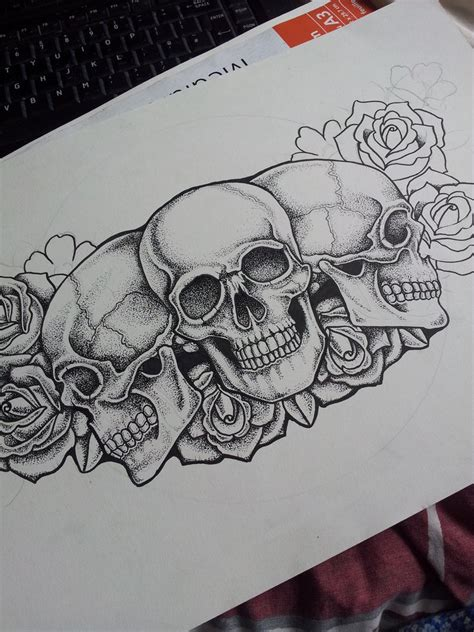 roses and skull tattoo ink on tiger and geometric tattoos