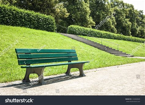 a park bench wooden park bench park stock photo 124460020 shutterstock