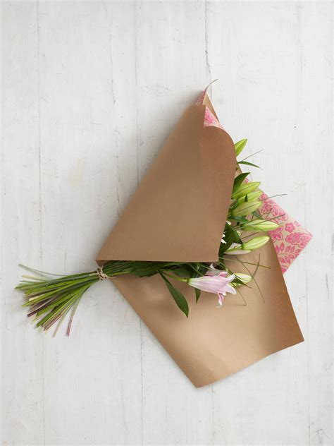 How To Make Wrapping Paper Flowers - how to wrap a bouquet of flowers hgtv