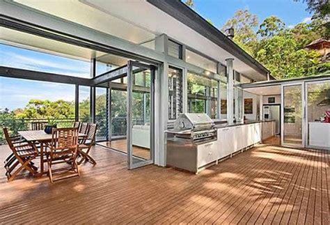 glass door utz luxury tree house with outdoor kitchen ideas
