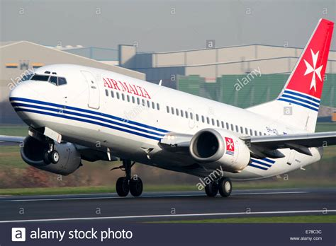 air malta boeing 737 300 climbs away from runway 23l at manchester stock photo royalty free