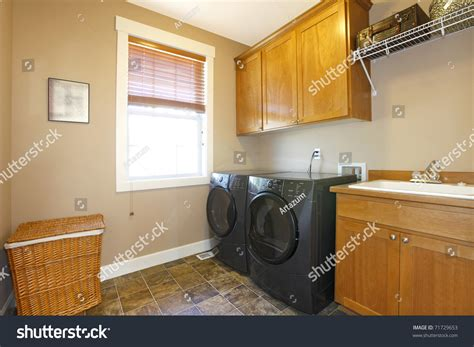 room appliances laundry room with black appliances and cabinets stock photo 71729653